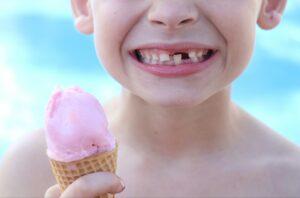 A boy enjoying yogurt on a hot day