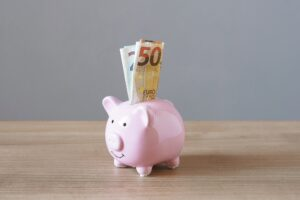 piggy bank with euro banknotes