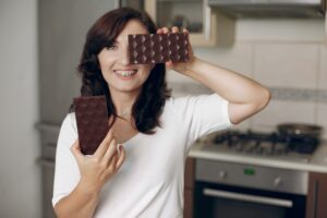 Woman holding chocolate in her hands.